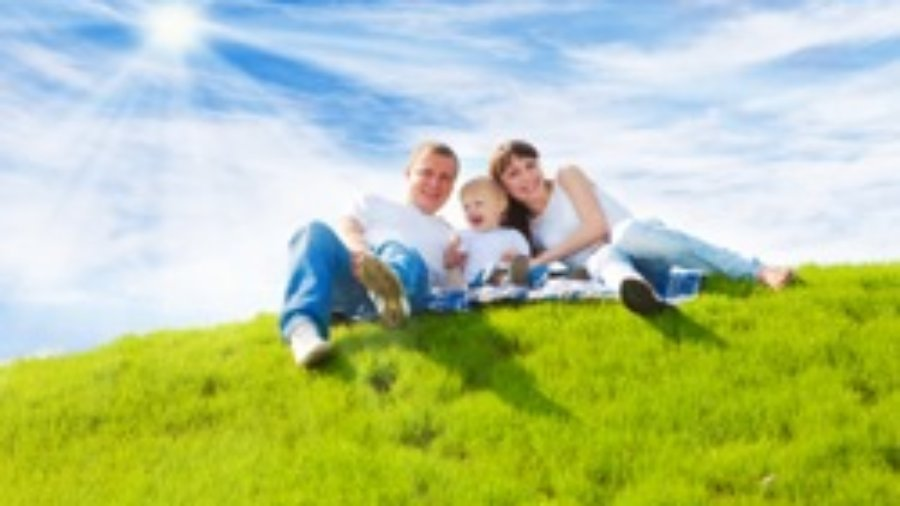 Family On Green Grass - hormone imbalance treatment in charlotte