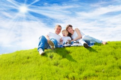 Family On Green Grass -