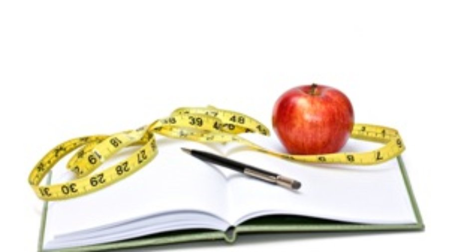 Book With Apple, Pen, and Measuring Tape - weight loss programs in charlotte
