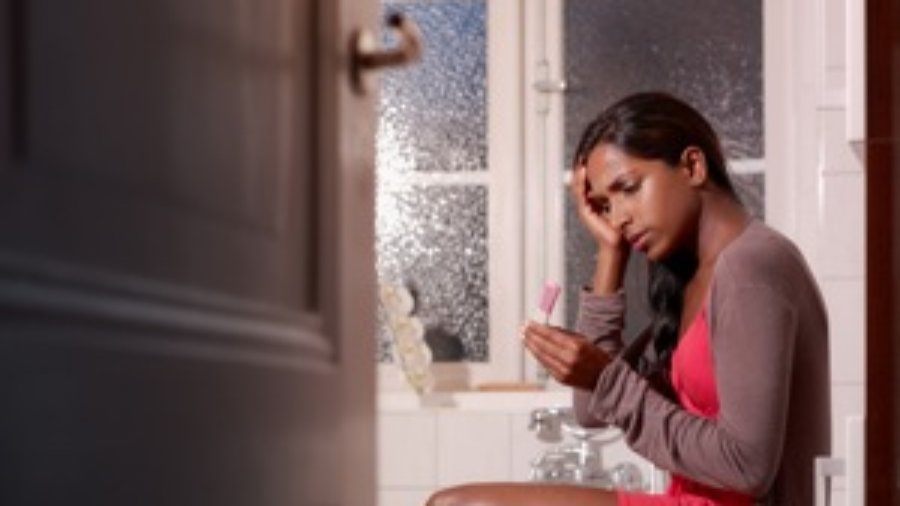 Woman In Bathroom - hormone imbalance treatment in charlotte