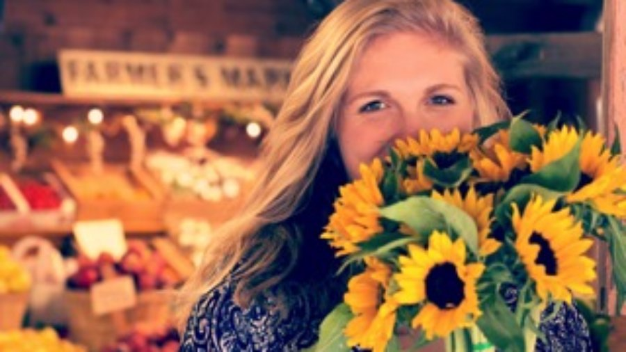 Woman Holding Flowers - charlotte autoimmune disorder treatment