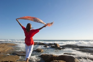 Woman Standing At Beach -