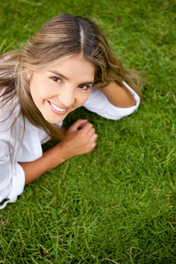 Smiling Woman On Grass -