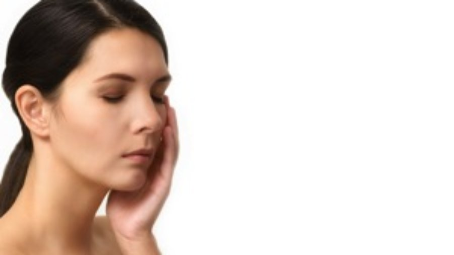 Woman Holding Her Face - charlotte migraine treatment