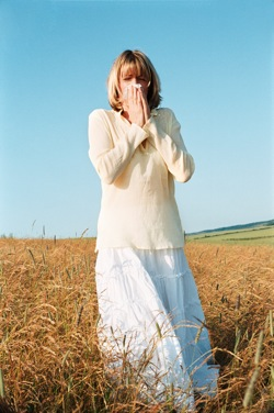 Woman With Allergies In Field -