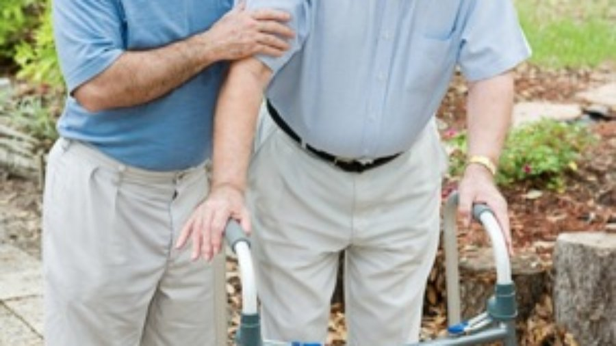 Man Helping Elderly Man - charlotte hormone imbalance treatment