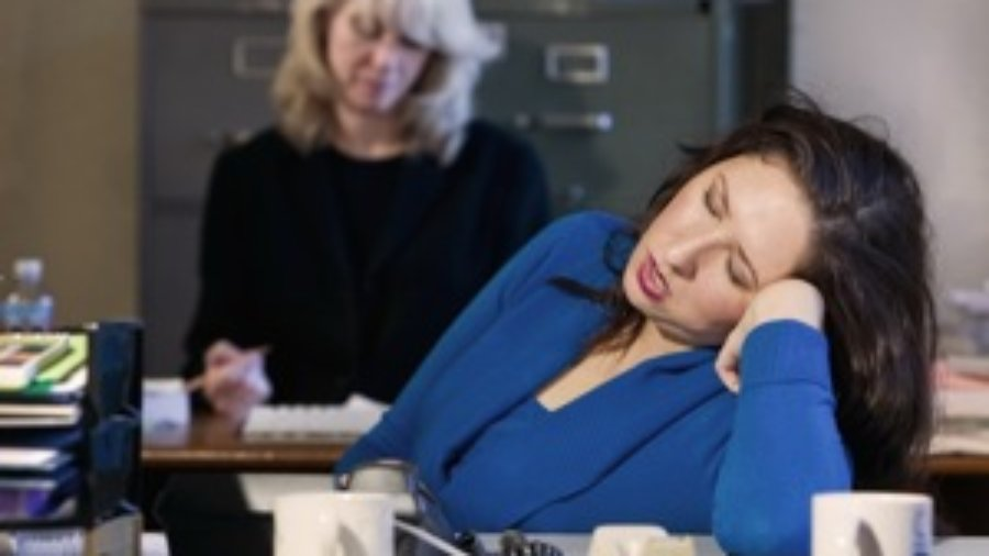 Women Sleeping At Office - hormone imbalance treatment in charlotte