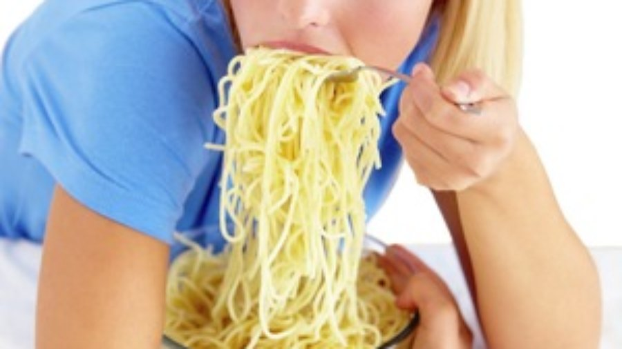 Woman Eating Noodles - charlotte weight loss programs
