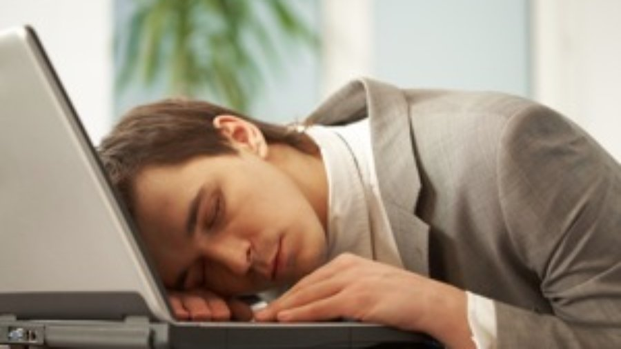 Man Asleep At Computer - charlotte hormone imbalance treatment