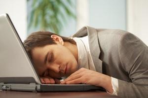 Man Asleep At Computer - charlotte hormone imbalance treatment