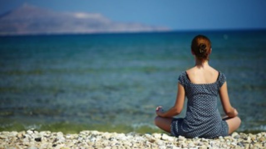 Woman Meditating At The Beach - charlotte hormone imbalance treatment