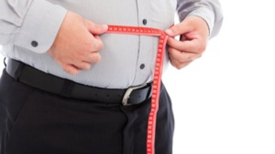 Man Measuring His Stomach - charlotte diabetes treatment