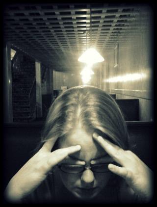 Child Holding Head - charlotte migraine treatment