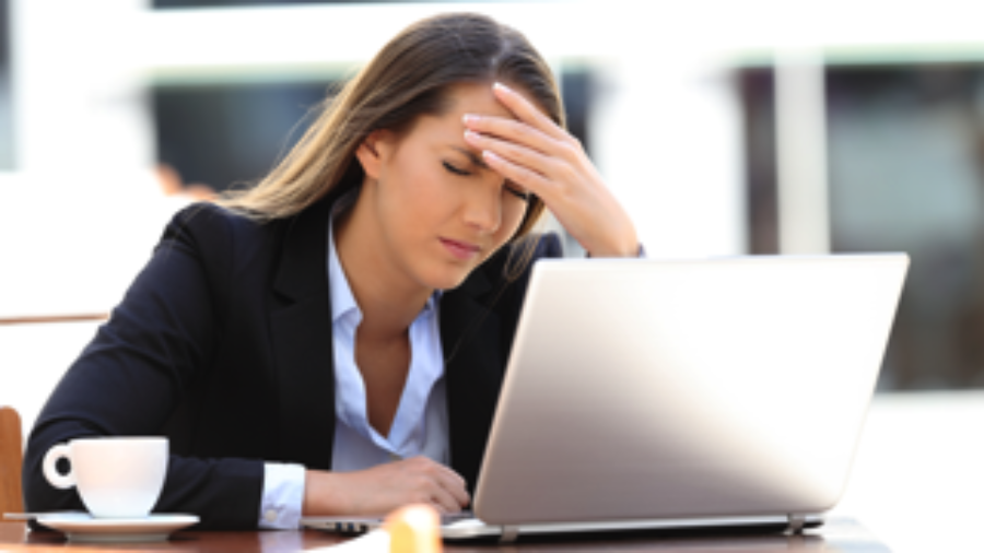 Confused Woman At Computer - migraine treatment in charlotte