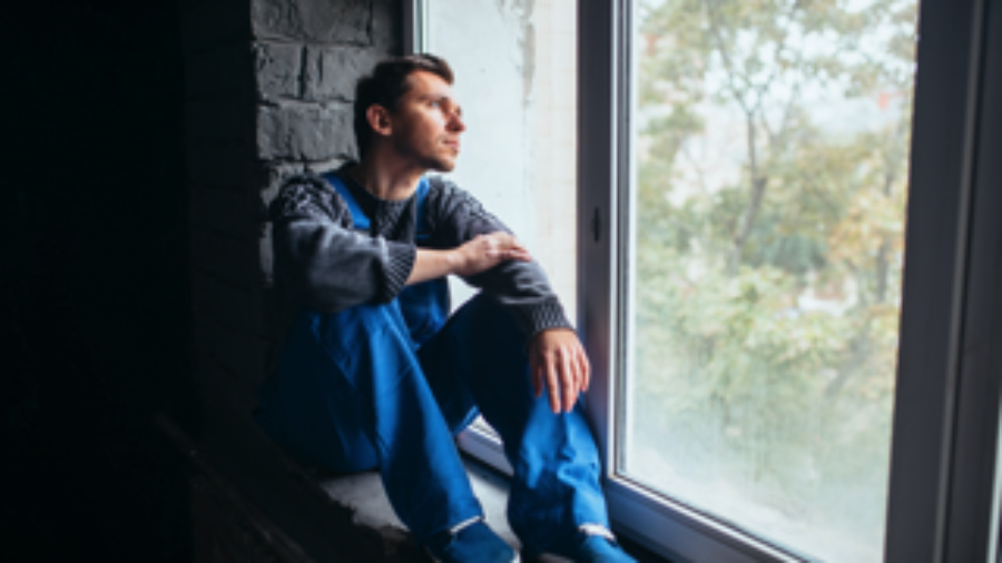 Man Sitting At Window - hormone imbalance treatment in charlotte
