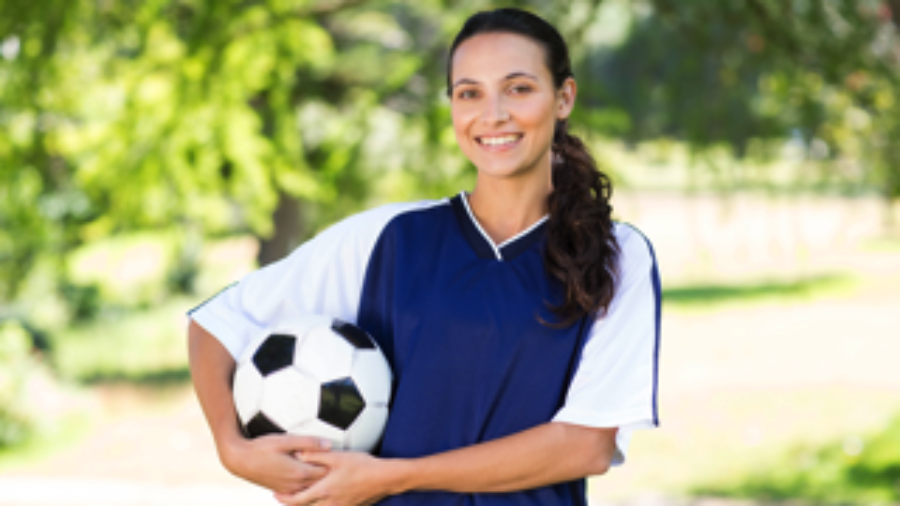 Woman Holding Soccer Ball - charlotte crohn's disease treatment