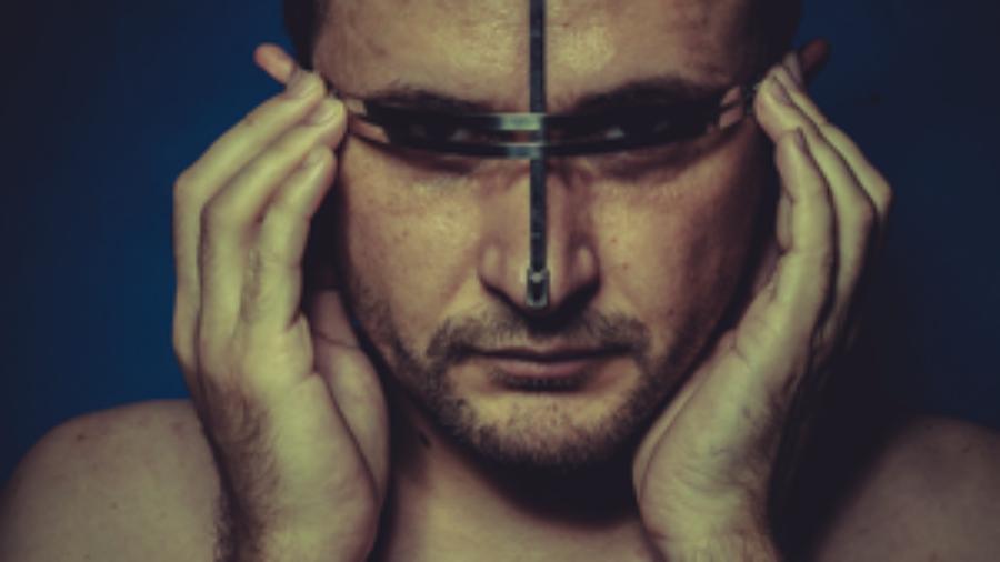 Man Holding His Head - autoimmune treatment in charlotte