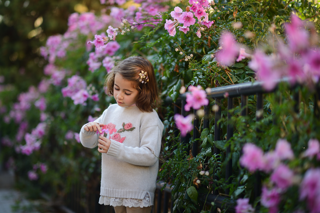 Young Girl Surrounded By Flowers - charlotte autoimmune treatment