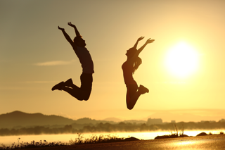 Couple Jumping In The Air - charlotte functional wellness