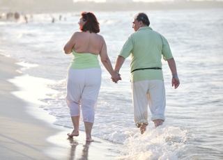 Couple Walking Along The Beach - charlotte erectile dysfunction treatment