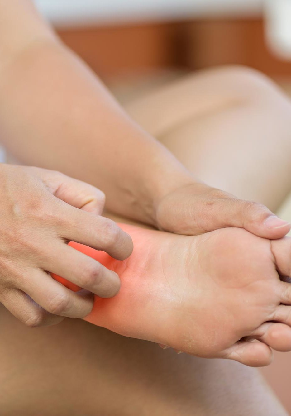 Close up woman foot scratch the itch by hand at home. Healthcare and medical concept.